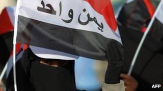 Yemen women hold a flat reading 'Yemen is One' during a demonstration on 11 Feb 2013