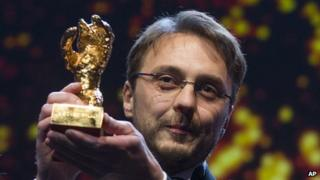 Director Calin Peter Netzer picks up the Golden Bear prize at the Berlin film festival on 16/2/13