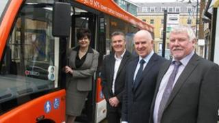Councillors and Courtney Buses staff with a new red bus