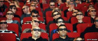 Fans watch on a screen with 3D glasses the Six Nations rugby union tournament final