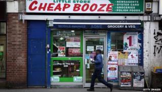 A man walks past a shop called Cheap Booze in Thornton Heath