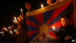 Exiled Tibetans participate in a candle vigil in solidarity with fellow Tibetans who have self immolated, in Kathmandu, Nepal