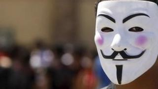 Man wearing Anonymous mask
