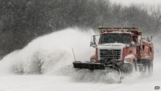 A snow plow clears a part of I-70 in Topeka, Kansas 21 February 2013