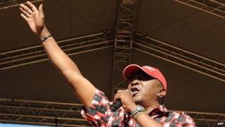 Kenya's Deputy Prime Minister and Jubilee alliance presidential candidate Uhuru Kenyatta delivers a speech during a political rally at Uhuru park in Nairobi (12 January 2013)
