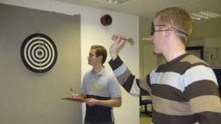 Dart throwing while blind, no concerns there