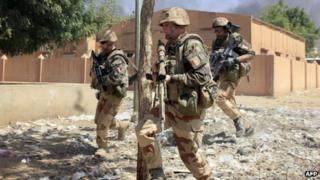 French soldiers running in Gao, Mali 21 February 2013