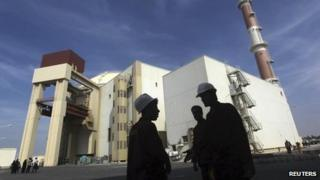 Iranian workers stand in front of the Bushehr nuclear power plant, about 1,200 km (750 miles) south of Tehran, in this October 2010 file photo