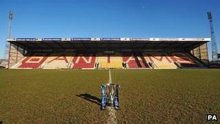 The League Cup trophy in front of the stand at Bradford City's stadium