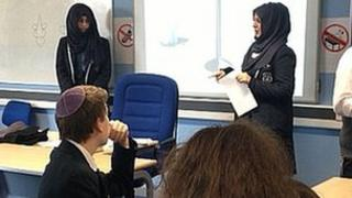 Muslim pupils speaking to a Jewish class