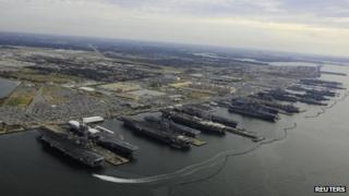 US aircraft carriers are pictured in port at at Naval Station Norfolk, Virginia