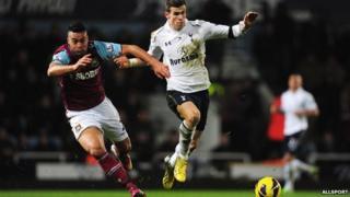 Tottenham Hotspur player Gareth Bale kicking football