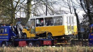 School bus on flatbed truck