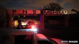 A policeman guards Mehran naval base in Karachi