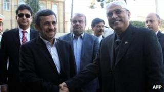 """Iran""""s President Mahmoud Ahmadinejad (L) shakes hands with Pakistan""""s President Asif Ali Zardari upon his arrival for a meeting on February 27"""