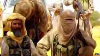 This Al-Andalus image grab taken on September 30, 2010 from a video released today shows Abu Zeid (L), also known as Abid Hammadou, posing with fighters of al-Qaeda in the Islamic Maghreb (AQIM)