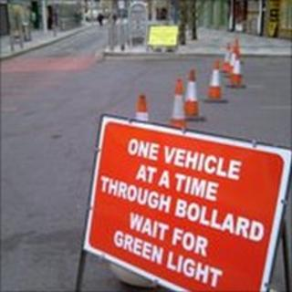 The red sign in Slough's High Street