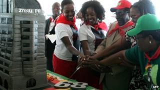 Zimbabwean President Robert Mugabe (centre) and his family cut cut the birthday cake in Bindura. Photo: 2 March 2013