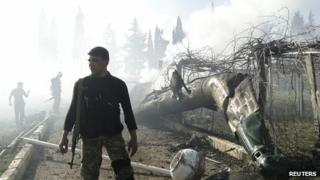 Rebels with wreckage of helicopter near Aleppo. 2 March 2013