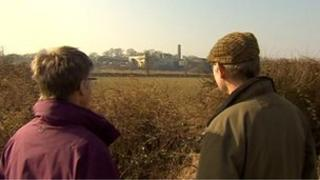 People looking towards a meat rendering plant in Market Harborough