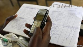 An electoral agent tallying votes in Kisumu, Kenya, on 5 March 2013