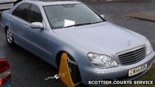 Clamped Mercedes car