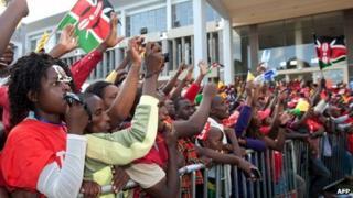 "Supporters of Kenyan presidential candidate Uhuru Kenyatta celebrate at the Catholic University where Uhuru Kenyatta gave the acceptance speech of his victory in Kenya""s national elections on March 9, 2013 in Nairobi."