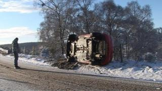 Overturned car on the A938