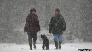 Woman and man in snow