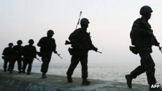 South Korean marines guard the Yeonpyeong island as tension deepens with Pyongyang