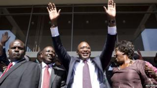 Uhuru Kenyatta (C) greets supporters beside his running mate William Ruto (2nd L) as they celebrate winning the presidential election after the official result was released in Nairobi. Kenya on 9 March 2013