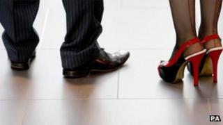 Man's feet and woman's feet