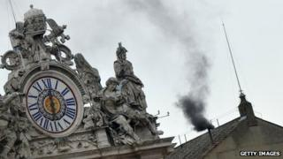 Black smoke issues from Sistine Chapel chimney