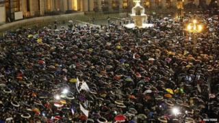 Crowds gather as they wait for the newly elected pope to appear on the balcony of St Peter's Basilica at the Vatican after being elected by the conclave of cardinals on Wednesday evening