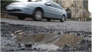 Car passing pothole