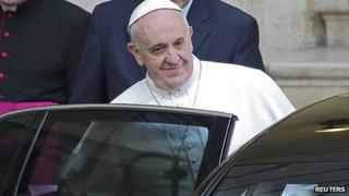 Pope Francis leaves after praying at Santa Maria Maggiore Basilica in Rome. 14 March 2013