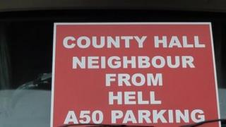 """One of the """"neighbour from hell"""" posters."""