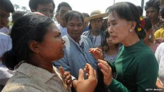Aung San Suu Kyi speaks to a Copper Mine protester