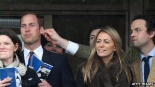 Duke of Cambridge having his ear pulled at Cheltenham races