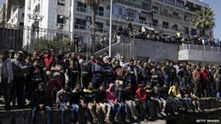 Residents of Port Said gather at a dock on the Suez Canal to demonstrate after the announcement of the final verdict in the case of the Port Said football massacre