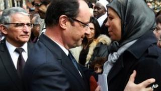 French President Francois Hollande, left, hugs Latifa Ibn Ziaten, mother of French soldier Imad ibn Ziaten, in Toulouse, March 17, 2013