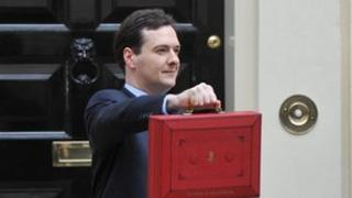 Chancellor of the Exchequer George Osborne holding the Budget box on Budget Day 21/03/2012