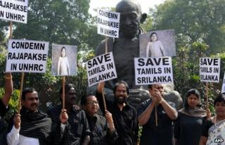 """In this photograph taken on March 5, 2013 Dravida Munnetra Kazhagam (DMK) Members of India""""s Parliament shout slogans and wave placards during a protest outside Parliament in New Delhi against Sri Lanka""""s President Mahinda Rajapaksa as they condemn the killing of Tamils in Sri Lanka."""