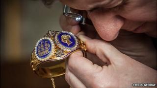James Bridges looking at the Royal wedding gift