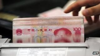 Yuan notes being counted