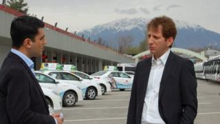 BBC Persian's Fardad Fahrazad meets Babak Zanjani in a car park in Dushanbe