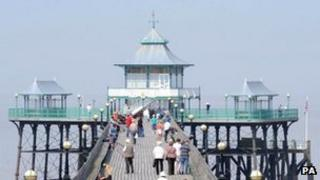 People enjoy warm weather on the Victorian Pier at Clevedon, North Somerset.