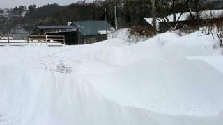 Snow on road to Hall Wabertwaite