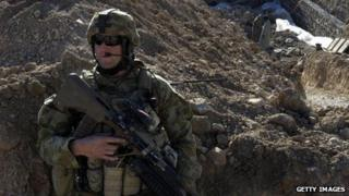 An Australian soldier (C) of Omlet-c company gestures during a NATO/ISAF joint task force patrol in Mirwais in the southern province of Uruzgan on January 20, 2010
