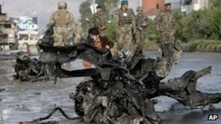 Afghan police and U.S. forces arrive to the scene after eight suicide bombers attacked a police headquarters in the eastern Afghan city of Jalalabad, Afghanistan, Tuesday, March 26, 2013
